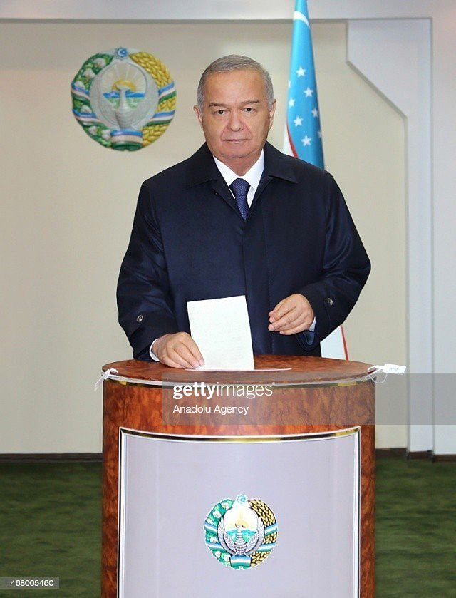 Uzbekistan's President Islam Karimov casts his ballot at a polling station during Uzbekistan's Presidential Election in Tashkent on March 29 2015...