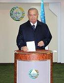 Uzbekistan's President Islam Karimov casts his ballot at a polling station during Uzbekistan's Presidential Election in Tashkent on March 29 2015...