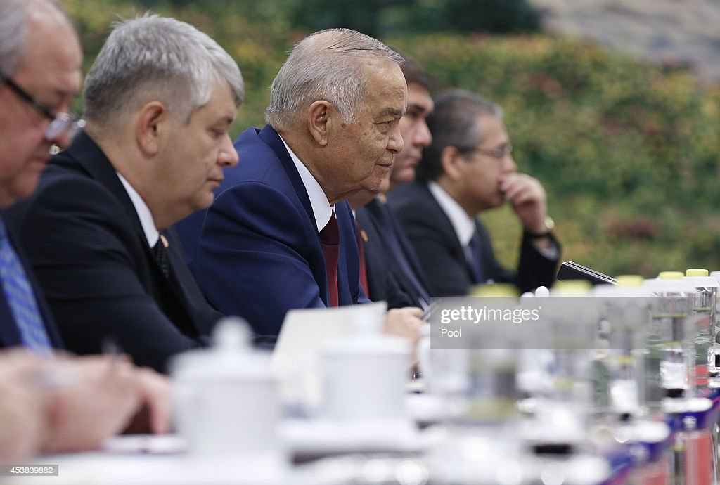 Uzbekistan's President Islam Karimov (3rd L) meets with Chinese Premier Li Keqiang at the Great Hall of the People on August 20, 2014 in Beijing, China.