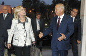 Uzbekistan's President Islam Karimov welcomes US Secretary of State Hillary Clinton upon her arrival in Tashkent on October 22 2011 US Secretary of...