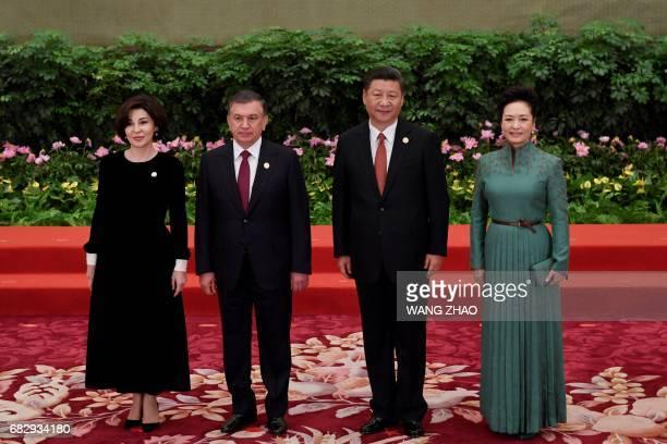 Uzbekistans President Shavkat Mirziyoyev and his wife Ziroatkhon Hoshimova pose with Chinese President Xi Jinping and his wife Peng Liyuan during a...