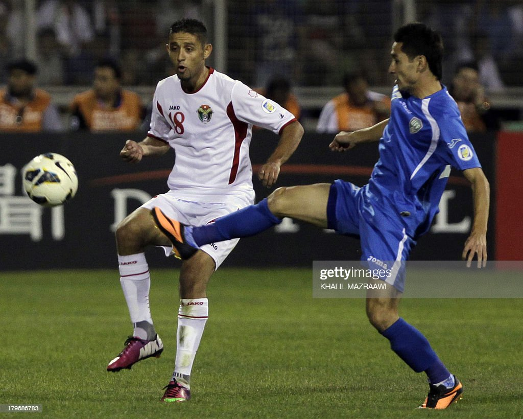 Uzbekistan's Sanjar Tursunov (R) challenges Jordan's Hasan Abdel Fattah (L) for the ball during their 2014 World Cup qualifier football match at the King Abdullah international stadium in Amman on September 6, 2012. The match ended in a draw.
