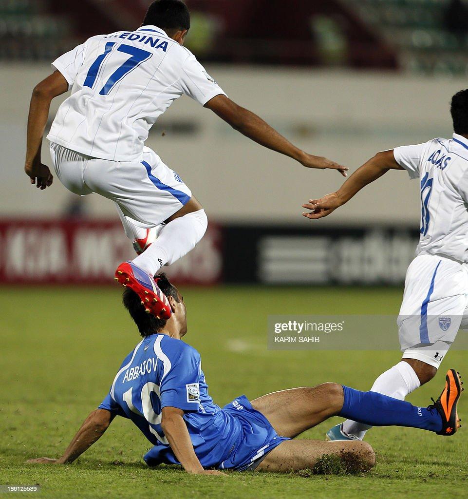 Uzbekistan's Shohjhon Abbasov (C) vies with Honduras' Fredy Medina (17) during their FIFA U-17 World Cup UAE 2013 football match on October 28, 2013, at the Sharjah Stadium in Sharjah. Honduras won the match 1-0.