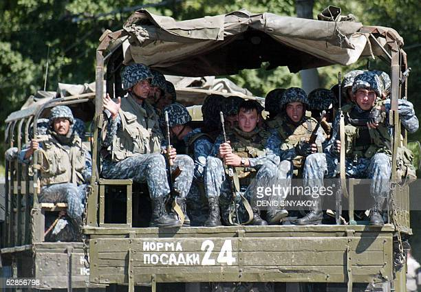 Uzbekistan's special forces soldiers sit on a military trucks patroling the streets of Uzbek town of Andijan 17 May 2005 More gunfire was heard early...