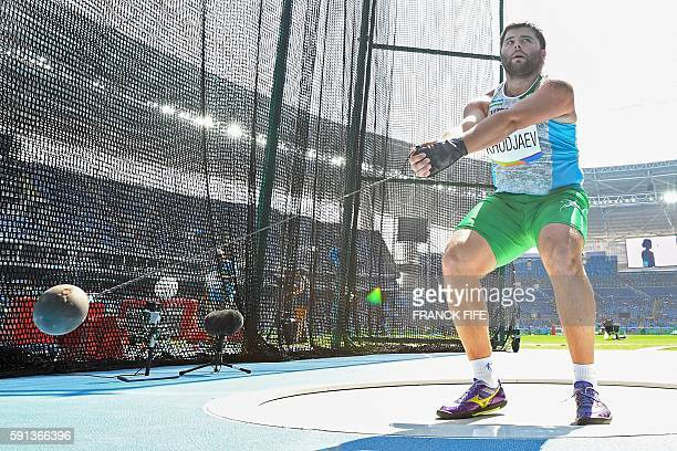Uzbekistan's Suhrob Khodjaev competes in the Men's Hammer Throw Qualifying Round during the athletics event at the Rio 2016 Olympic Games at the...