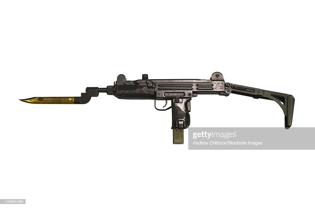 Uzi 9mm submachine gun with attached bayonet.