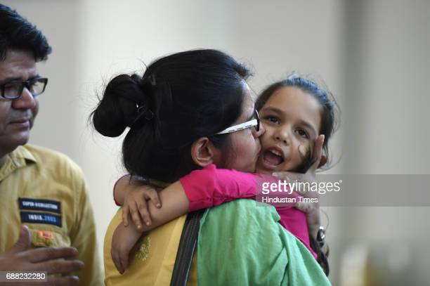 Uzma Ahmed hugs her daughter during her meeting with External Minister Sushma Swaraj at Jawahar Bhawan after returning from Pakistan on May 25 2017...