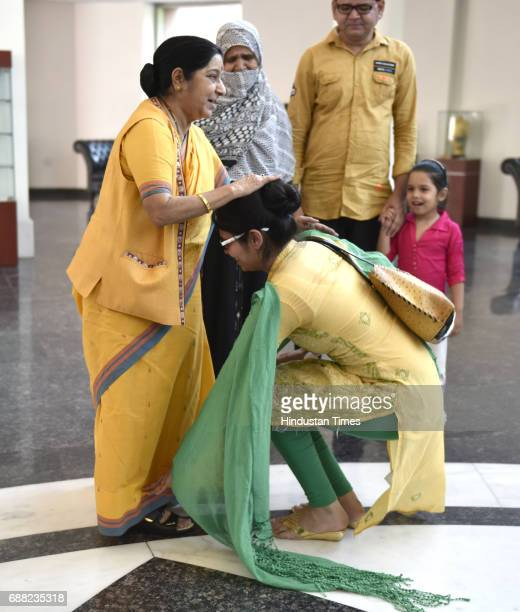 Uzma Ahmed touches feet of Union External Affairs Minister Sushma Swaraj at Jawahar Bhawan after returning from Pakistan on May 25 2017 in New Delhi...