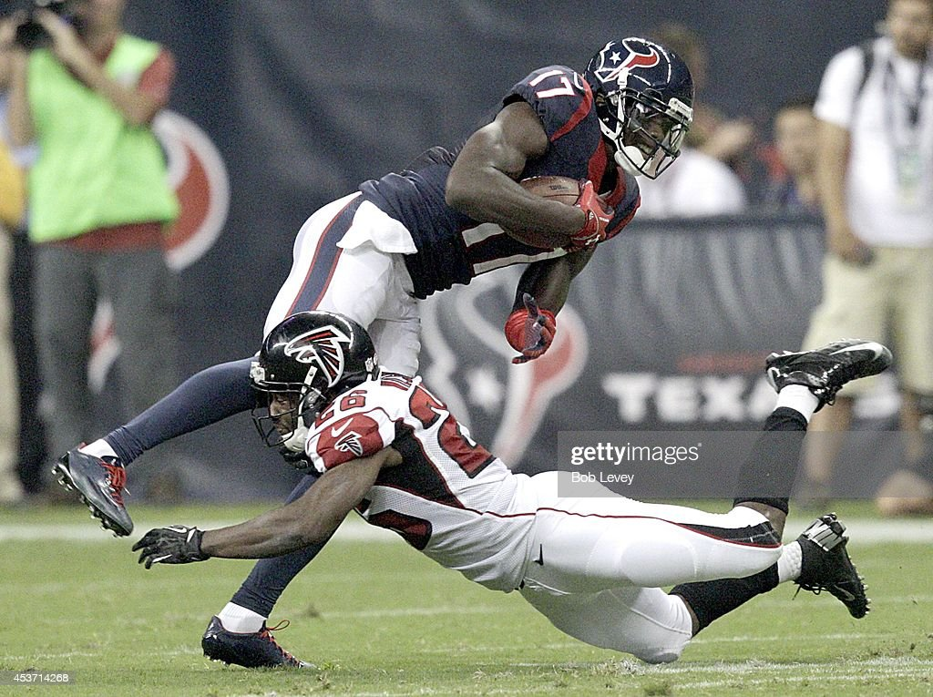 Uzoma Nwachukwu #17 of the Houston Texans is tackled by Josh Wilson #26 of the Atlanta Falcons in the third quarter in a pre-season NFL game on August 16, 2014 at NRG Stadium in Houston, Texas.