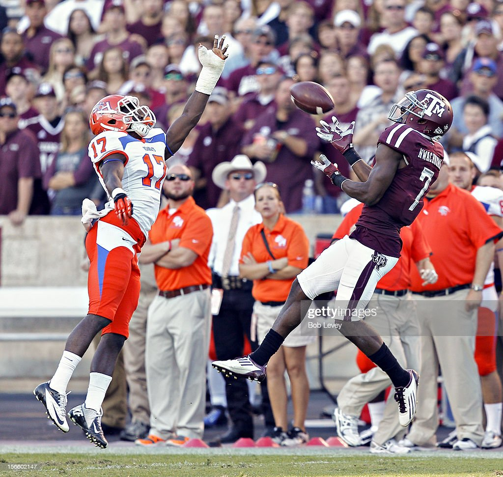 Uzoma Nwachukwu #7 of the Texas A&M Aggies completes a catch as he beats Bookie Sneed #17 of the Sam Houston State Bearkats on the play at Kyle Field on November 17, 2012 in College Station, Texas.