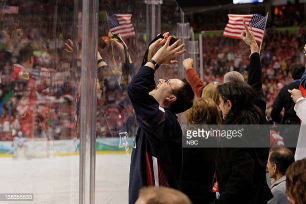GAMES USA v Canada Men's Hockey Pictured American and Canadian fans cheer for their hometown heroes