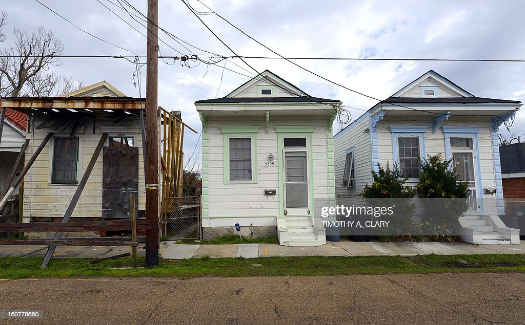 A vacant home (L) stands next to two rebuilt houses in the Lower Ninth Ward of New Orleans on February 5, 2013. The Ninth Ward suffered the worst damage from Hurricane Katrina that occured in 2005 after multiple breaches in the levees of at least four canals. As of March 2009, hundreds of houses have been rebuilt, and dozens of new homes have been constructed.
