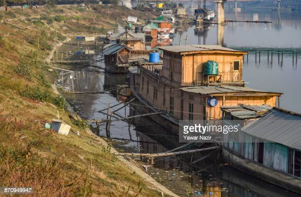 Vacant house boats are moored to the bank of river jehlum in Kashmir on November 06 2017 in Srinagar the summer capital of Indian administered...