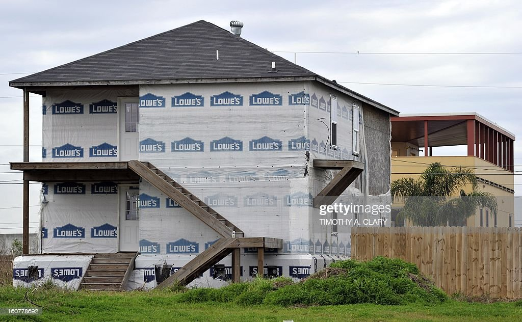 A vacant house sits in front of One of the modular houses built by the Brad Pitt's Make It Right Foundation in the Lower Ninth Ward of New Orleans on February 5, 2013. Pitt rasied $30 million for the project that consists of hurricane-proof homes. This area suffered the worst damage from Hurricane Katrina that occured in 2005 after multiple breaches in the levees of at least four canals. As of March 2009, hundreds of houses have been rebuilt, and dozens of new homes have been constructed.