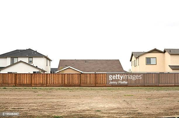 Vacant lot behind suburban houses