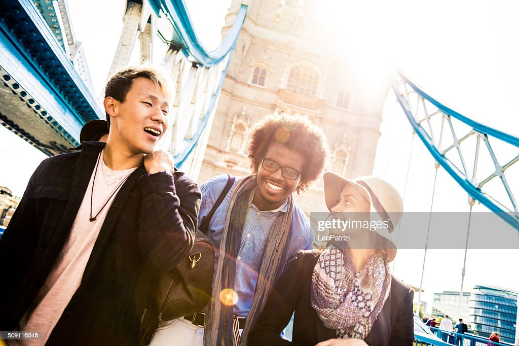 Vacation in London with friends on Tower Bridge : Stock Photo