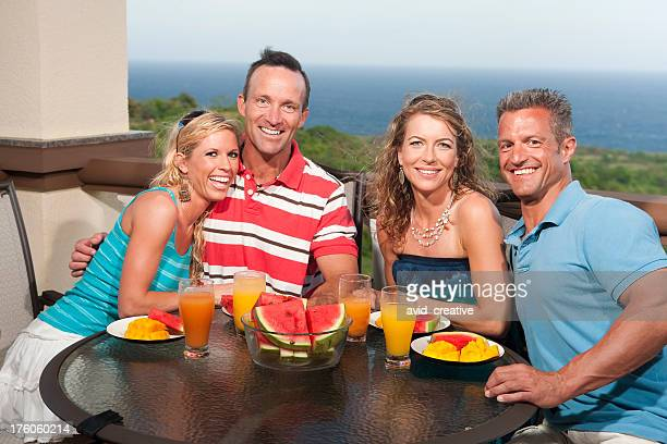 Vacation Lifestyles-Friends Eating on Balcony