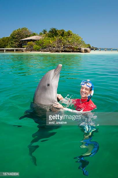 Vacation Lifestyles-Man Swimming with Dolphin