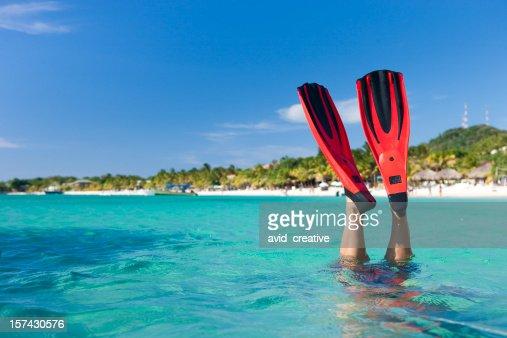Vacation Lifestyles-Snorkeler Diving in Ocean