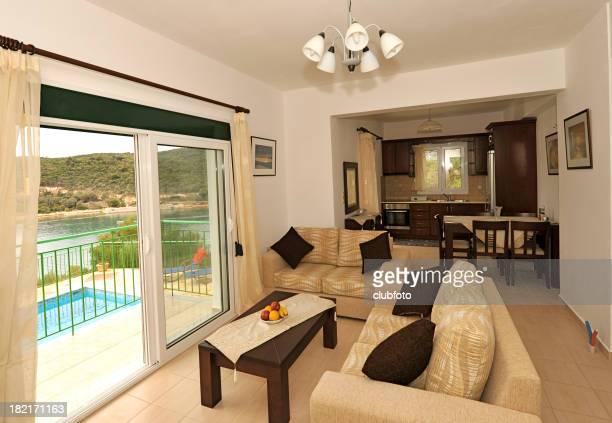 Vacation villa interior, lounge and kitchen, swimming pool views