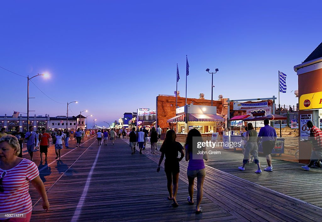 Vacationers strolling along the boardwalk in summer