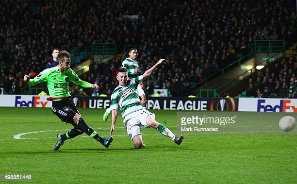 Vaclav Cerny of Ajax shoots past Callum McGregor of Celtic to score their second goal during the UEFA Europa League Group A match between Celtic FC...