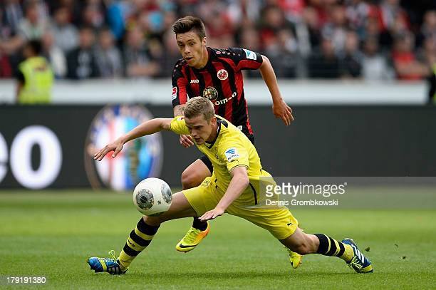 Vaclav Kadlec of Eintracht Frankfurt challenges Sven Bender of Borussia Dortmund during the Bundesliga match between Eintracht Frankfurt and Borussia...