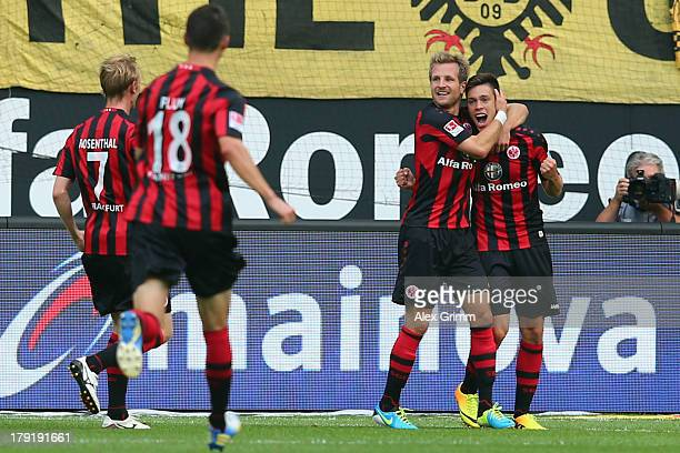 Vaclav Kadlec of Frankfurt celebrates his team's first goal with team mates Stefan Aigner Johannes Flum and Jan Rosenthal during the Bundesliga match...