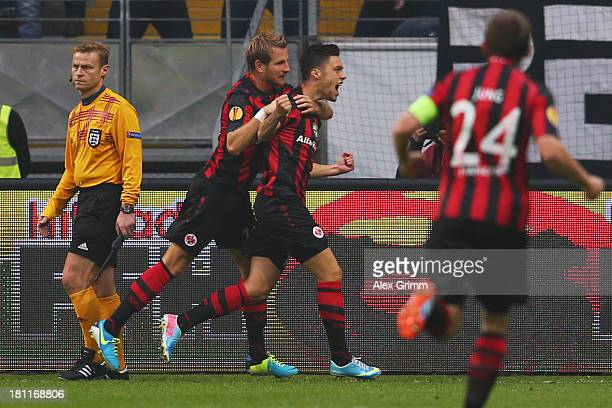 Vaclav Kadlec of Frankfurt celebrates his team's first goal with team mates Stefan Aigner and Sebastian Jung during the UEFA Europa League Group F...