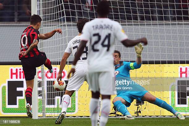 Vaclav Kadlec of Frankfurt scores his team's first goal against goalkeeper Cedric Carrasso of Bordeaux during the UEFA Europa League Group F match...