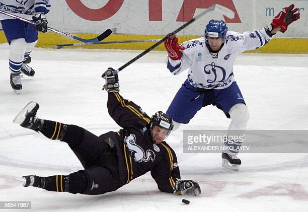 Vaclav Petka of Russia's Dynamo Moscow trips Ari Vallin of Finland's Karpat Oulu during the final of the European Champions Cup in Saint Petersburg...