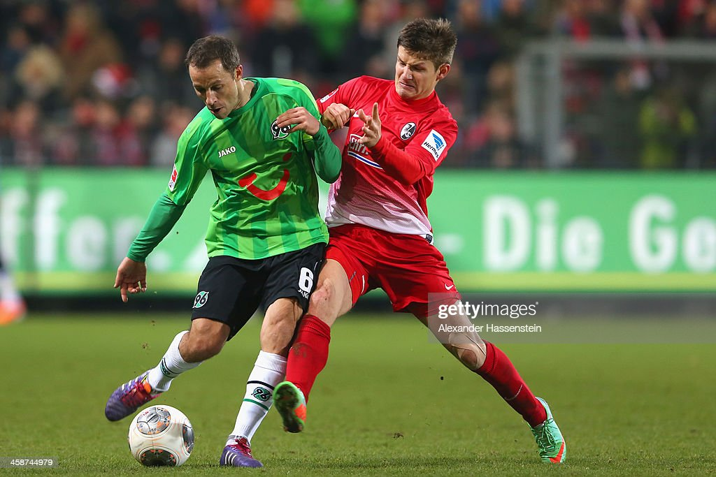 Vaclav Pilar of Freiburg battles for the ball with Steven Cherundolo of Hannover during the Bundesliga match between SC Freiburg and Hannover 96 at...