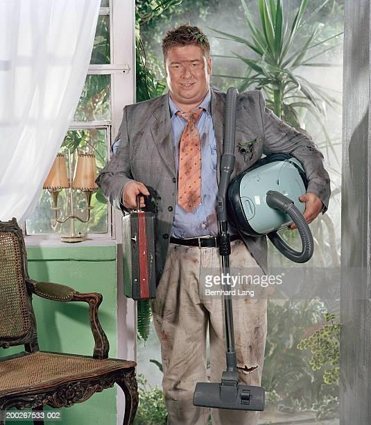 Vacuum cleaner salesman in doorway, covered in grime
