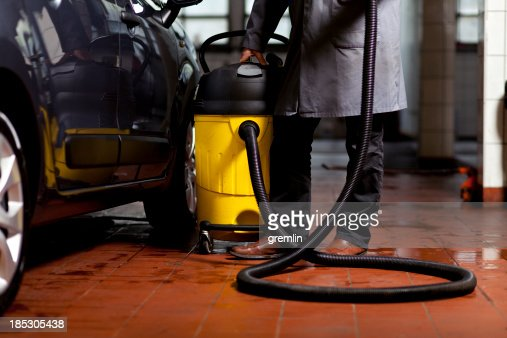 vacuum cleaning car interior stock photo getty images. Black Bedroom Furniture Sets. Home Design Ideas