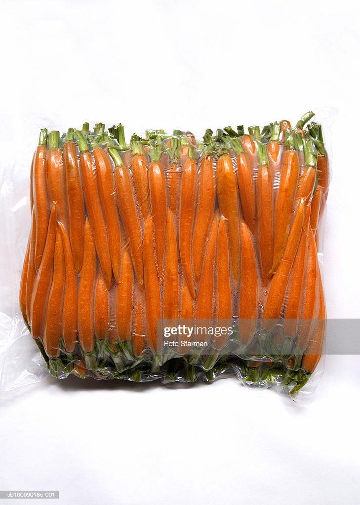 Vacuum packed baby carrots, studio shot : Stock Photo