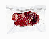 Vacuum sealed frozen cut of beef