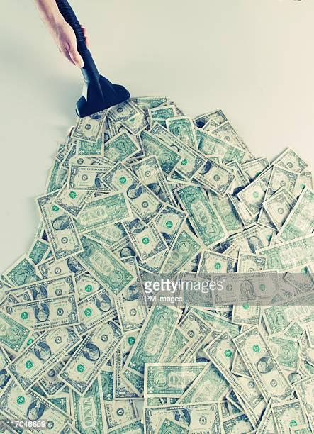 Vacuum sucking up money