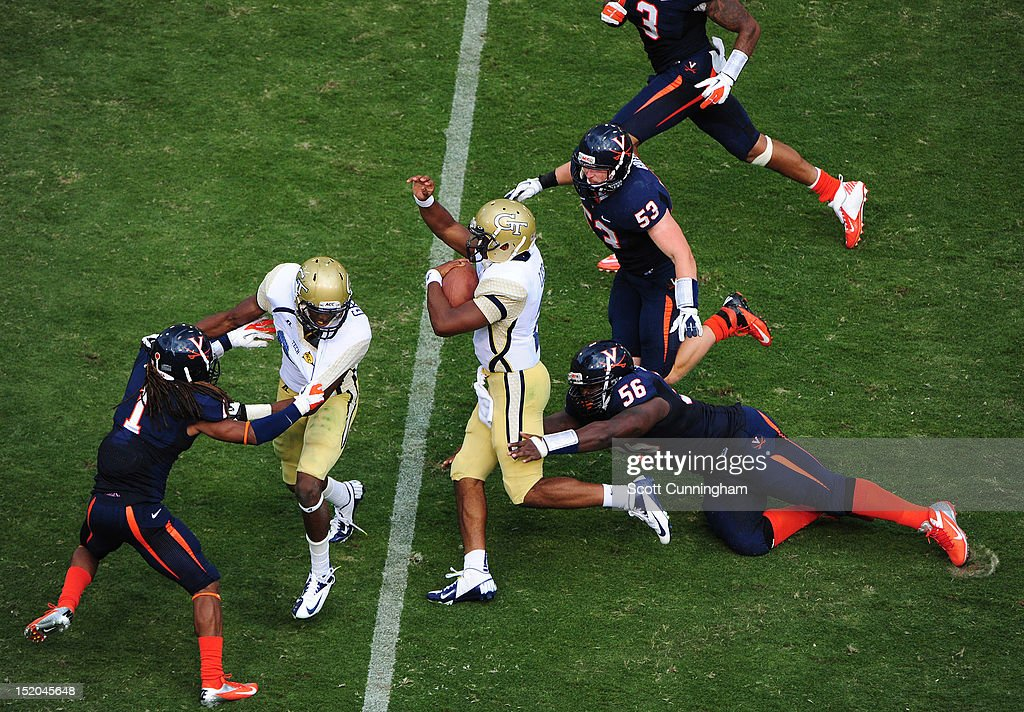 Vad Lee #2 of the Georgia Tech Yellow Jackets carries the ball against Chris Brathwaite #56 and Steve Greer #53 of the Virginia Cavaliers at Bobby Dodd Stadium on September 15, 2012 in Atlanta, Georgia.