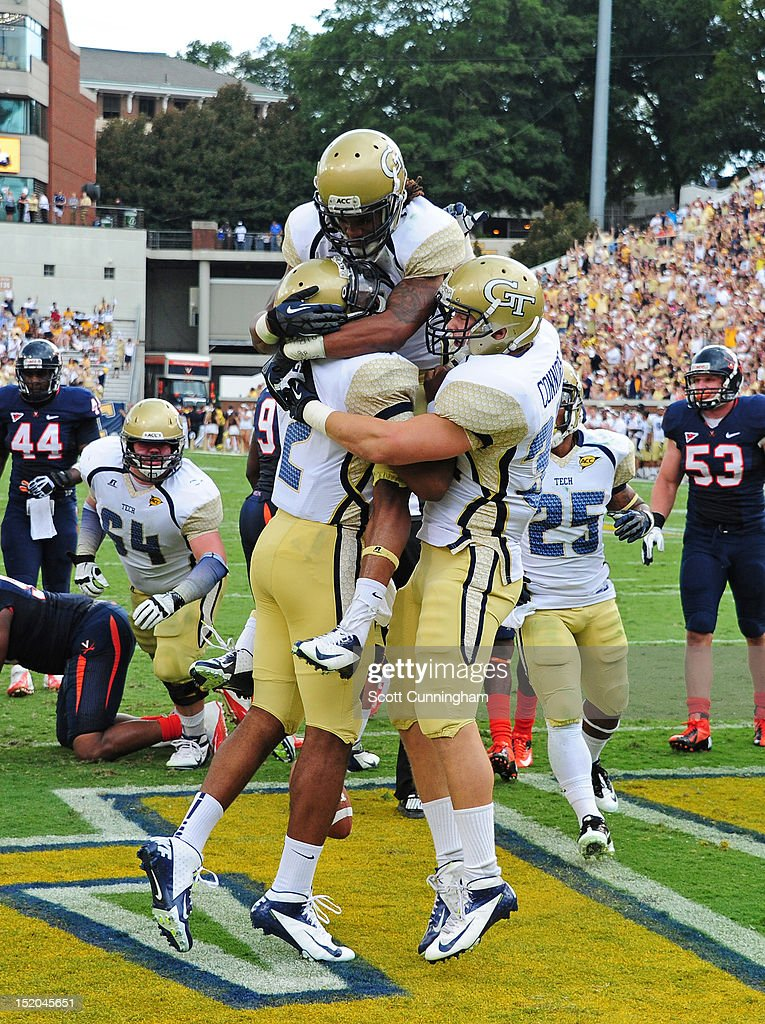Vad Lee #2 of the Georgia Tech Yellow Jackets is congratulated by B. J. Bostic #7 and Matt Connors #34 after scoring a touchdown against the Virginia Cavaliers at Bobby Dodd Stadium on September 15, 2012 in Atlanta, Georgia.