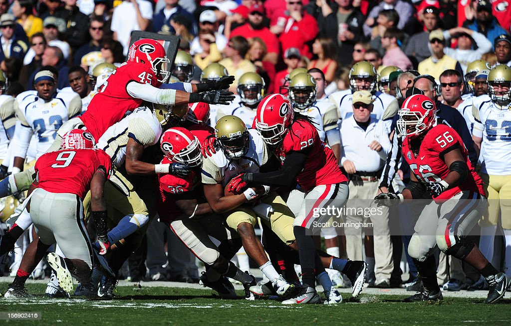 Vad Lee #2 of the Georgia Tech Yellow Jackets is tackled by <a gi-track='captionPersonalityLinkClicked' href=/galleries/search?phrase=Jarvis+Jones&family=editorial&specificpeople=6236463 ng-click='$event.stopPropagation()'>Jarvis Jones</a> #29 and Shawn Williams #36 of the Georgia Bulldogs at Sanford Stadium on November 24, 2012 in Athens, Georgia.