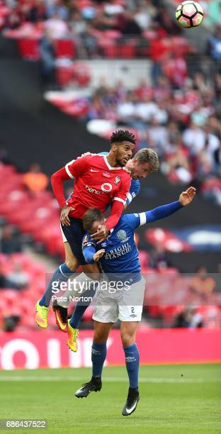 Vadaine Oliver of York City rises above Andy Halls and Neill Byrne of Macclesfield Town to head the ball during The Buildbase FA Trophy Final between...