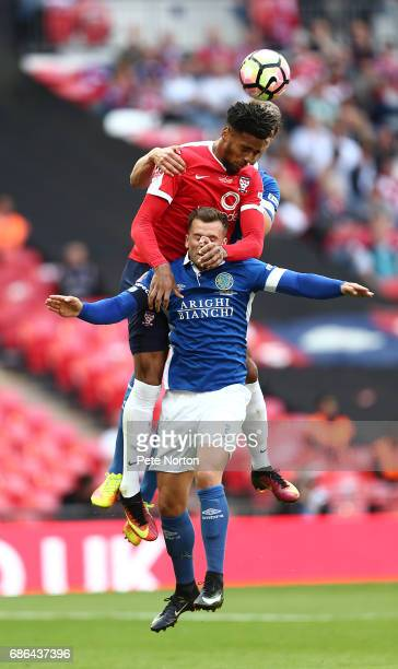 Vadaine Oliver of York City rises above Andy Halls of Macclesfield Town to head the ball during The Buildbase FA Trophy Final between York City and...