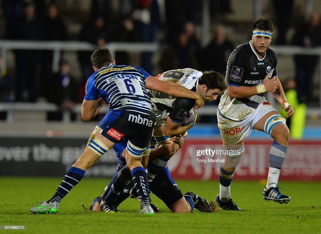 Vadim Cobilas and Mark Easter of Sale Sharks tackles <a gi-track='captionPersonalityLinkClicked' href=/galleries/search?phrase=Johnnie+Beattie&family=editorial&specificpeople=4355668 ng-click='$event.stopPropagation()'>Johnnie Beattie</a> of Castres Olympique during the European Rugby Challenge Cup match between Sale Sharks and Castres Olympique at AJ Bell Stadium on December 19, 2015 in Salford, England.