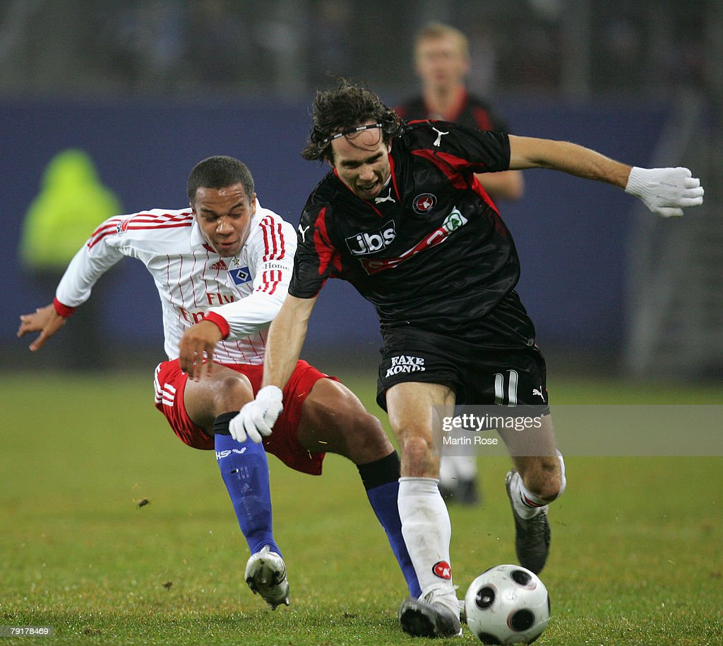 Vadis Odjidja (L) of Hamburg and Petter Furuseth (R) of Midtjyiland compete for the ball during the friendly match between Hamburger SV and FC Midtjyland at the HSH Nordbank Arena on January 23, 2008 in Hamburg, Germany.
