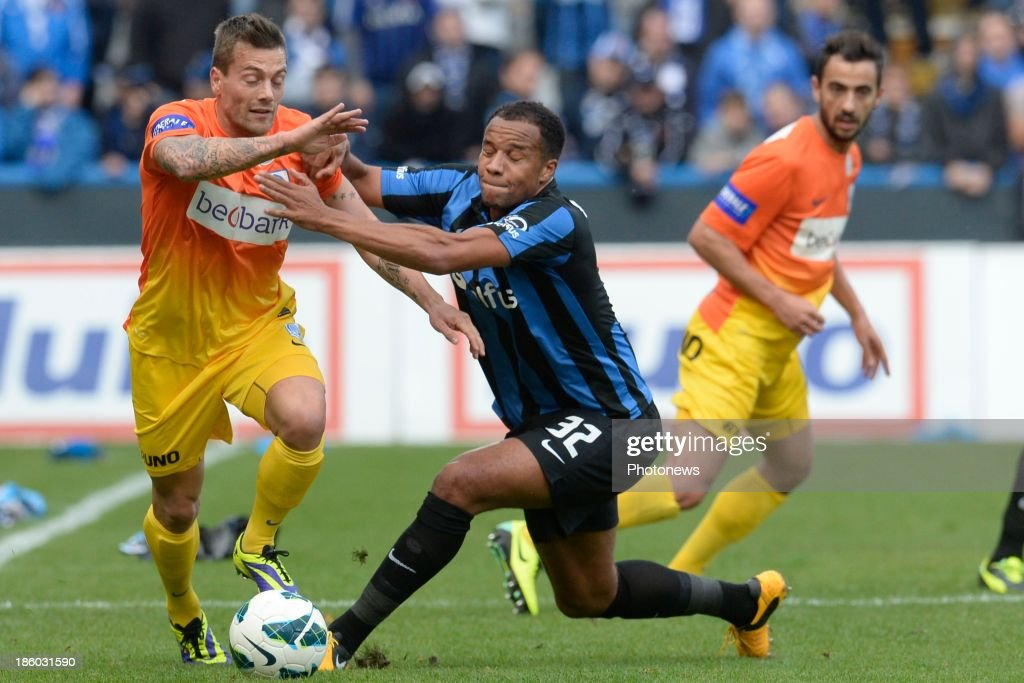 Vadis Odjidja Ofoe of Club Brugge battles for the ball with Benji De Ceulaer of KRC Genk during the Jupiler Pro League match between Club Brugge KV and KRC Genk on October 27, 2013 in Brugge, Belgium.