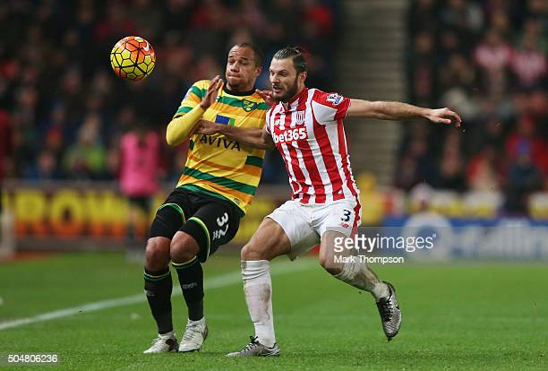 Vadis Odjidja Ofoe of Norwich City and Erik Pieters of Stoke City compete for the ball during the Barclays Premier League match between Stoke City...