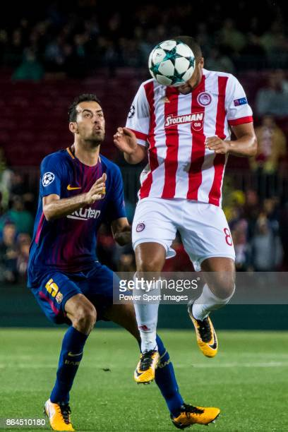 Vadis Odjidja Ofoe of Olympiacos FC fights for the ball with Sergio Busquets Burgos of FC Barcelona during the UEFA Champions League 201718 match...