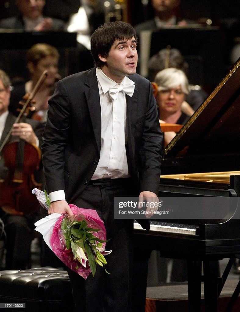Vadym Kholodenko, of the Ukraine, takes a bow after his performance in the finals of the Van Cliburn International Piano Competition at Bass Performance Hall in Fort Worth, Texas, Friday, June 7, 2013.