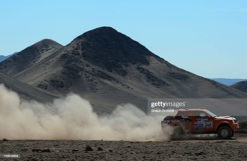 Vadym Nesterchuk and co-driver Vladimir Demyanenko of team Mitsubishi compete in stage 12 from Fiambala to Copiapo during the 2013 Dakar Rally on January 17, 2013 in Fiambala, Argentina.