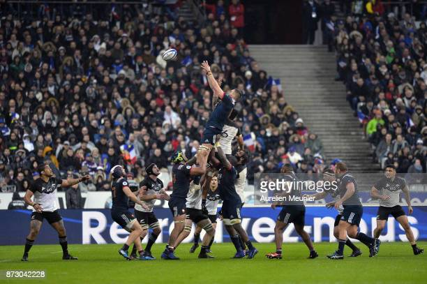 Vaea Fifita of New Zealand and Paul Jedrasiak of France jump for the ball during the test match between France and New Zealand at Stade de France on...